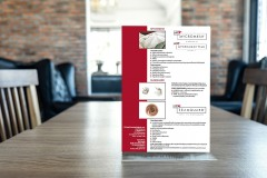 Blank screen mock up menu frame standing on wood table in coffee cafe and restaurant background