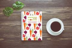 Bouquet of flower and empty diary notebook and a cup of coffee on rustic wooden table with copy space, mockup template with flower and note, top view, vintage retro style.